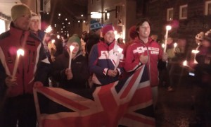 Photo of Jasmin Taylor and the British Ski Team marching through the streets of Rauris